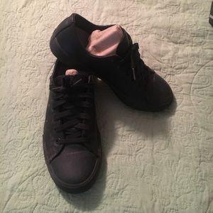 Slip resistant Skechers work shoes.